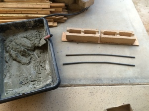 Bent rebar, cut blocks, and mortar, ready for assembly
