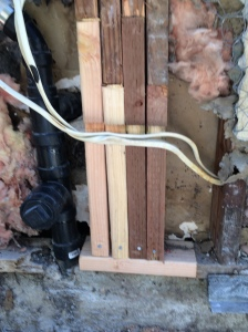 Replacement studs, interlocked, nailed, and notched for the electrical wires.