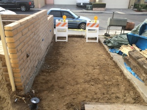 Left driveway apron ready for gravel backfill