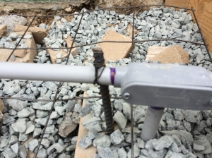 PVC electrical conduit is supported by rebar stakes so that it won't bend when the concrete is poured over it.
