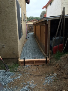 Service sidewalk all ready. I'm replacing the square grates with round ones on the advice of the subcontractor to minimize cracking.