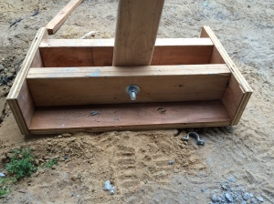 Picture of the shoe of the post jack. The bolt allows the jack to pivot into position, and the shoe provides a stable base.