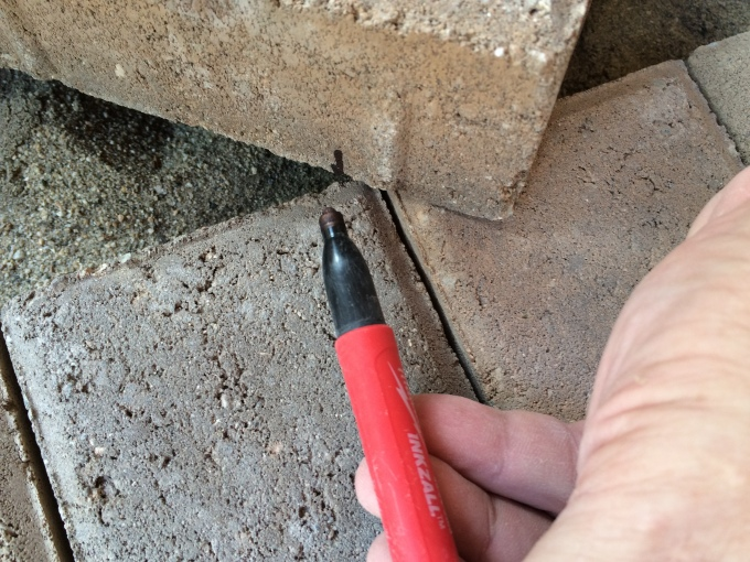 Step #2: Mark where the brick intersects the edge.
