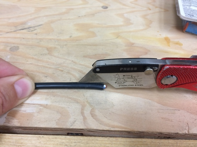 Cut the sheath of the control wire cable with a utility knife. All you need to do is to get it started. Since you might damage the control wires when you do this, allow sufficient slack so that you can cut this end off after you strip the sheath.