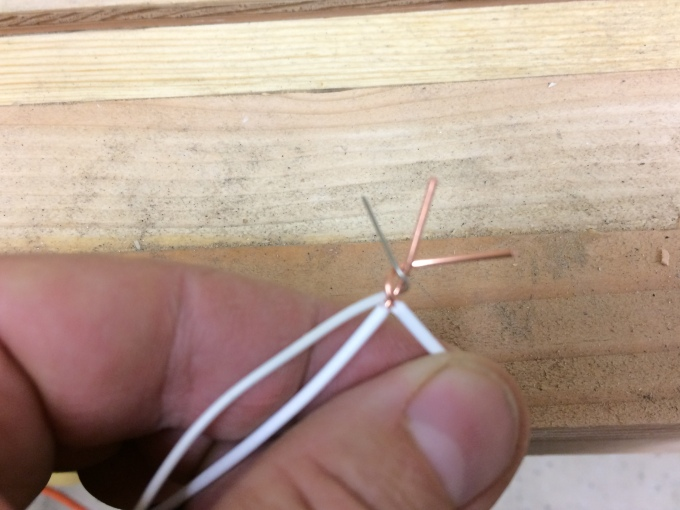 To twist the wire, line up the wires at the ends of the insulation and then twist clockwise.