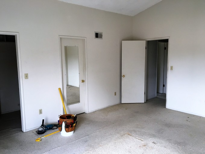 A last look at our master bedroom before the remodel. Notice the demolition tools at the ready.