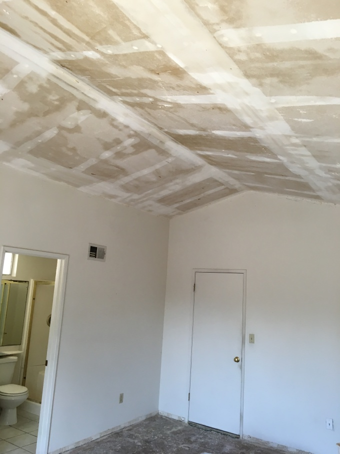 The bedroom ceiling free of that nasty asbestos popcorn.