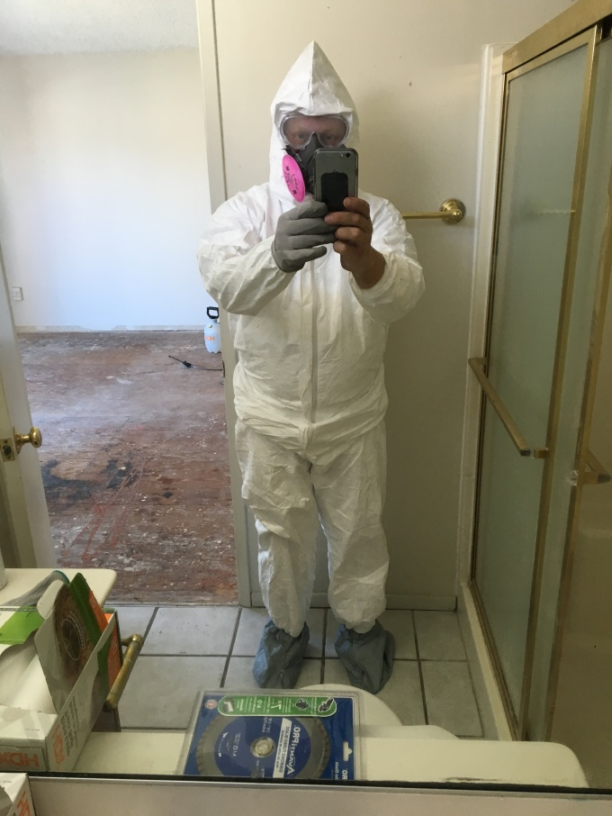 All suited up for asbestos! I needed to have one hand ungloved to take the picture. Otherwise, I'm ready to go!