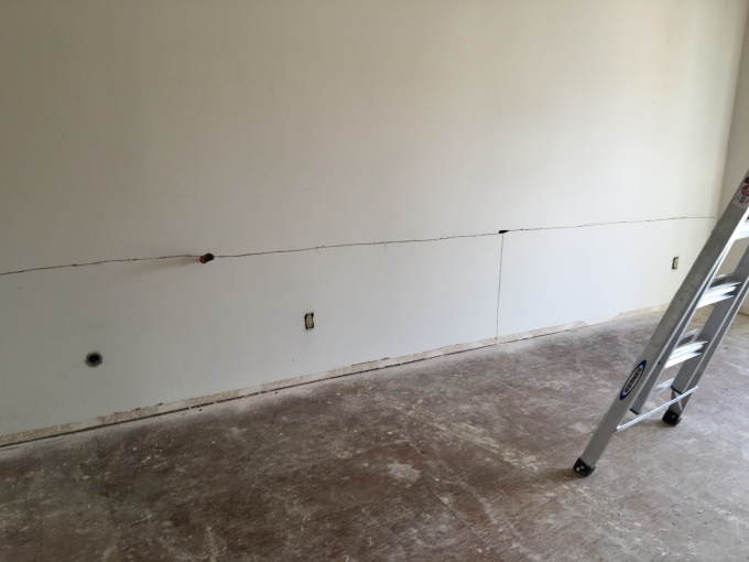 The drywall is cut into sections to ease removal.