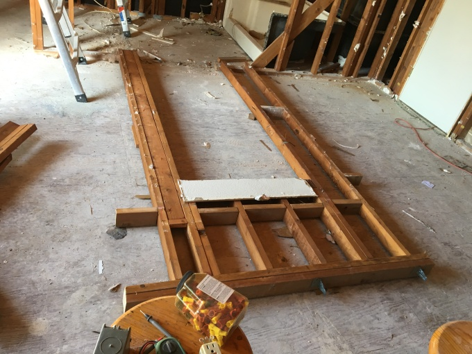 Section of wall framing on the floor, ready to knock apart.