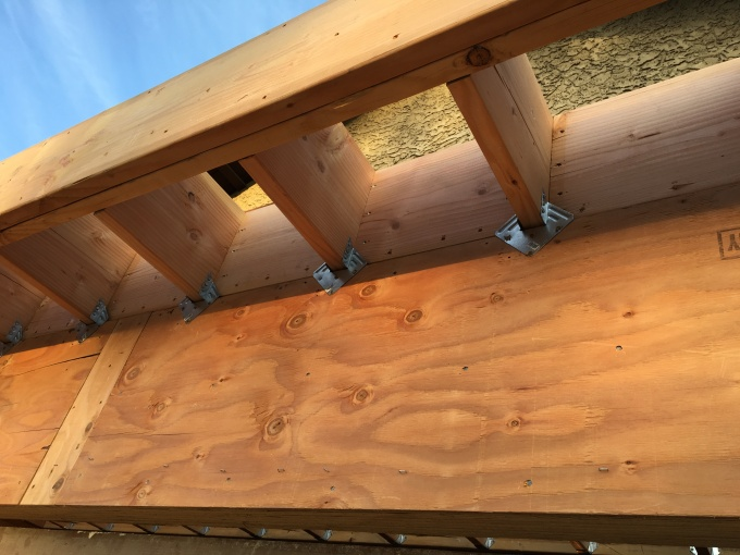 Blocking detail. These are short blocks of wood that fit in between the joists. This not only gives the structure a lot of additional strength, but also squares up the joists nicely. Note the tight fit in the corners. Really looks nice!