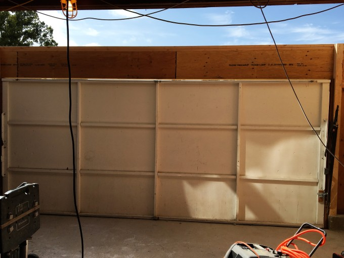 The garage door re-installed and my tools safe from random thievery.