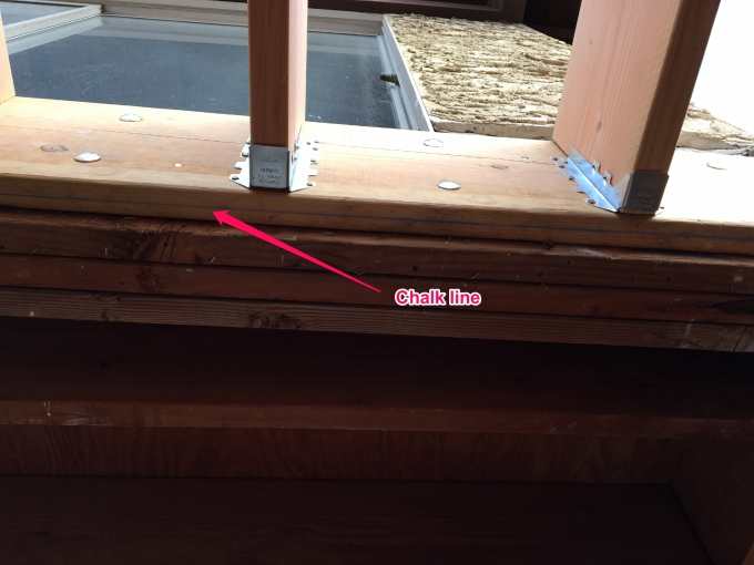 Notice the difference in the position of the chalk line. This shows the bow in the existing beam.