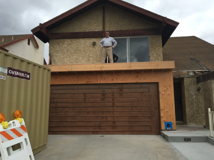 The proud builder atop his masterpiece.