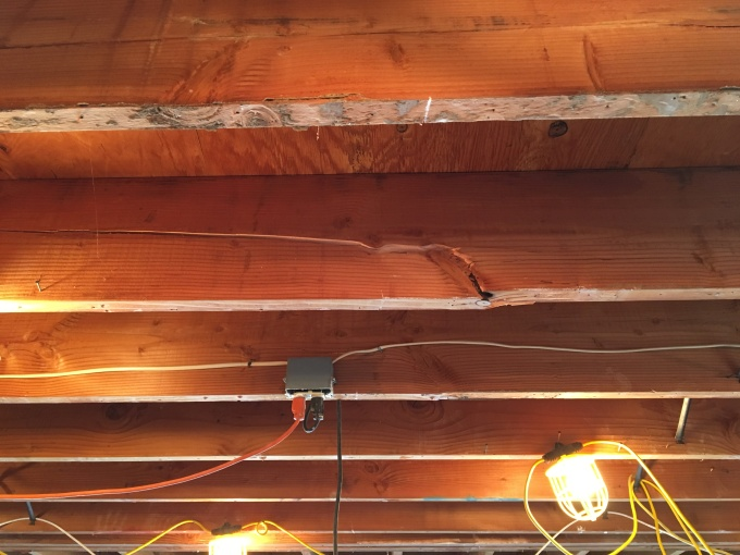 Joist failure as a result of not properly transferring the load to the foundation. I'm going to put a bag over my head when I call my engineer for recommendations.