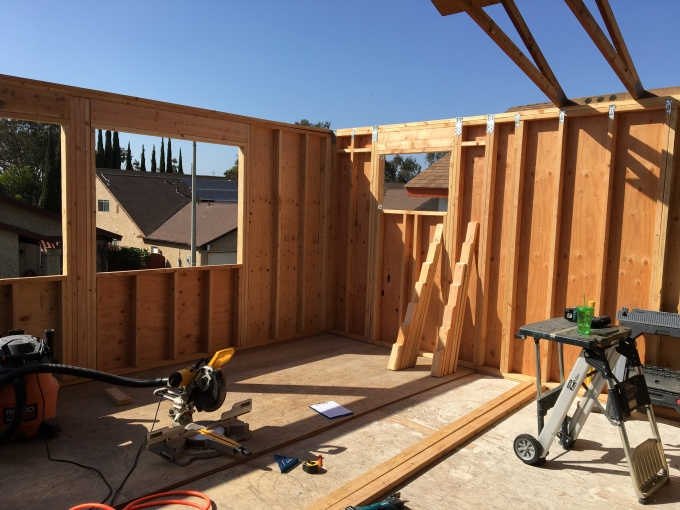 Last wall up, ready for trusses.