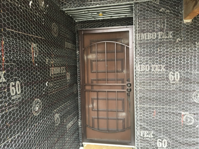 Nice lath job around the front door.