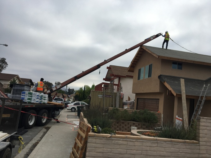 Loading the roof. The shingles come in packages of 33 square feet each (1/3 of a