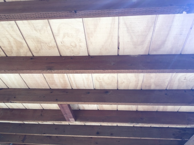 My roofing contractor recommended that I use T1-11 siding for my patio roof sheathing. The idea is that you put it on upside down, and it instantly makes a nice overhead pattern for a minimal extra cost. Looks WAY better than CDX plywood! Truly a great recommendation.