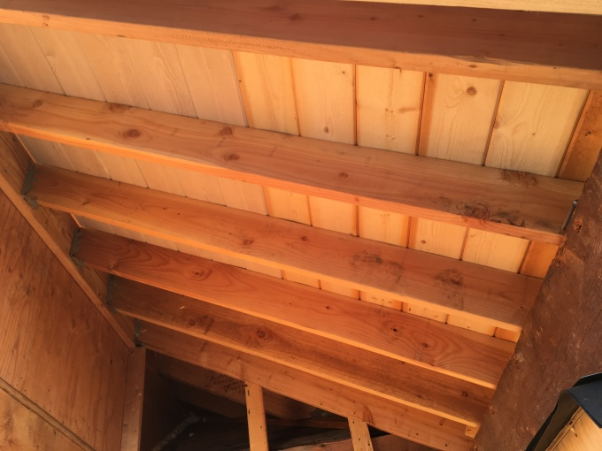 Underside of the porch roof matches the shiplap of the eaves.